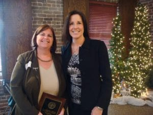 Ms. Caffey presented an award to outgoing ETLAW President Debra House.
